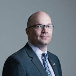 Dr. Kristopher Wells