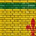 Le drapeau fransaskois peinturé sur un mur de briques.