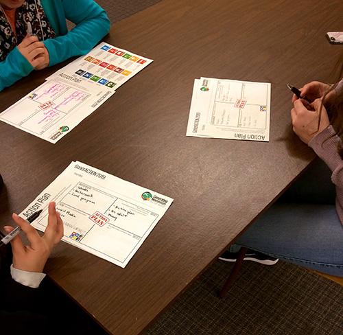 Children fill out an action plan.