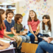 Teacher laughing with group of students
