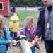 Photo of students petting goat