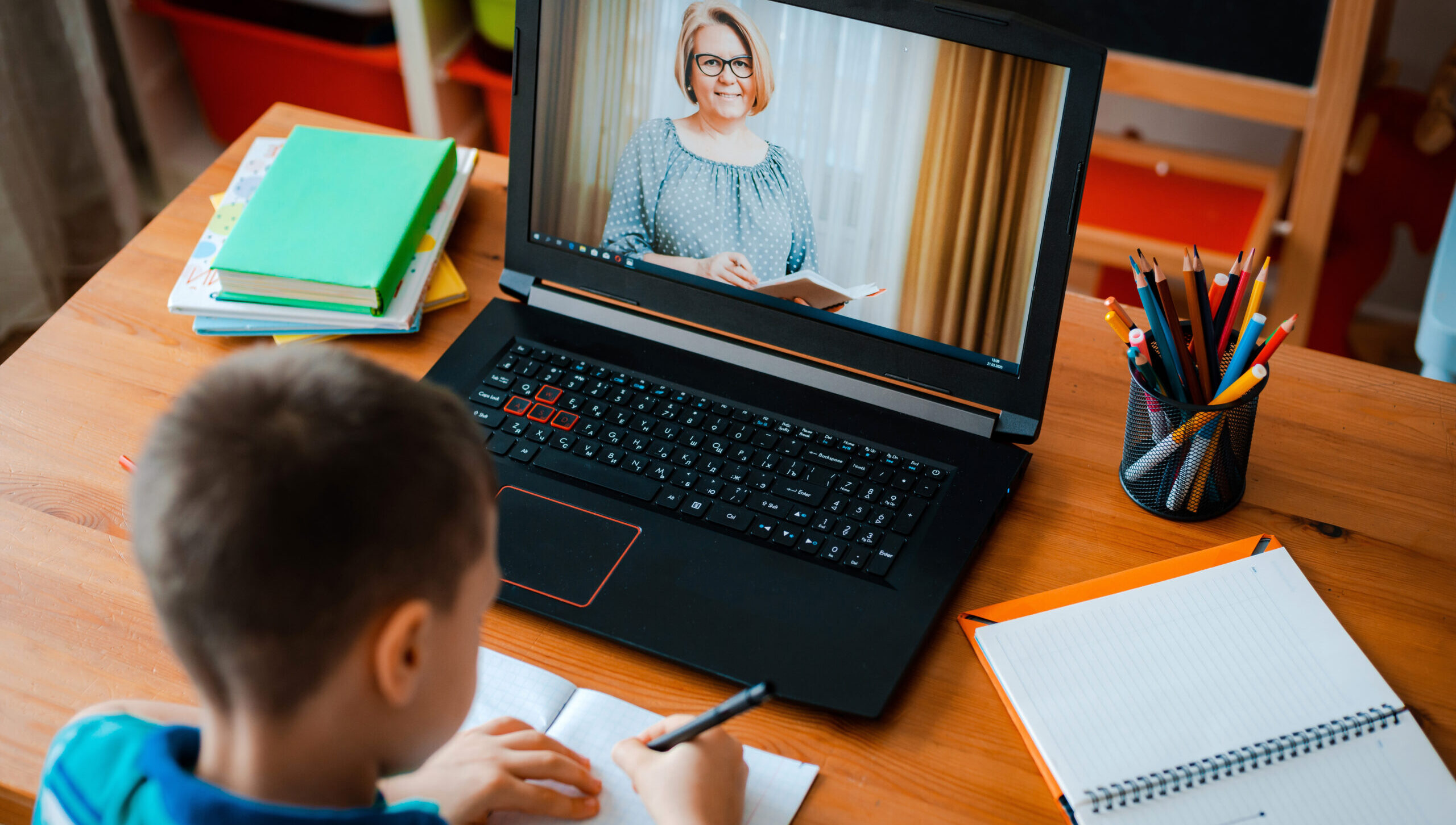Distance learning online education. A schoolboy boy studies at home and  does school homework. A home distance learning | EdCan Network
